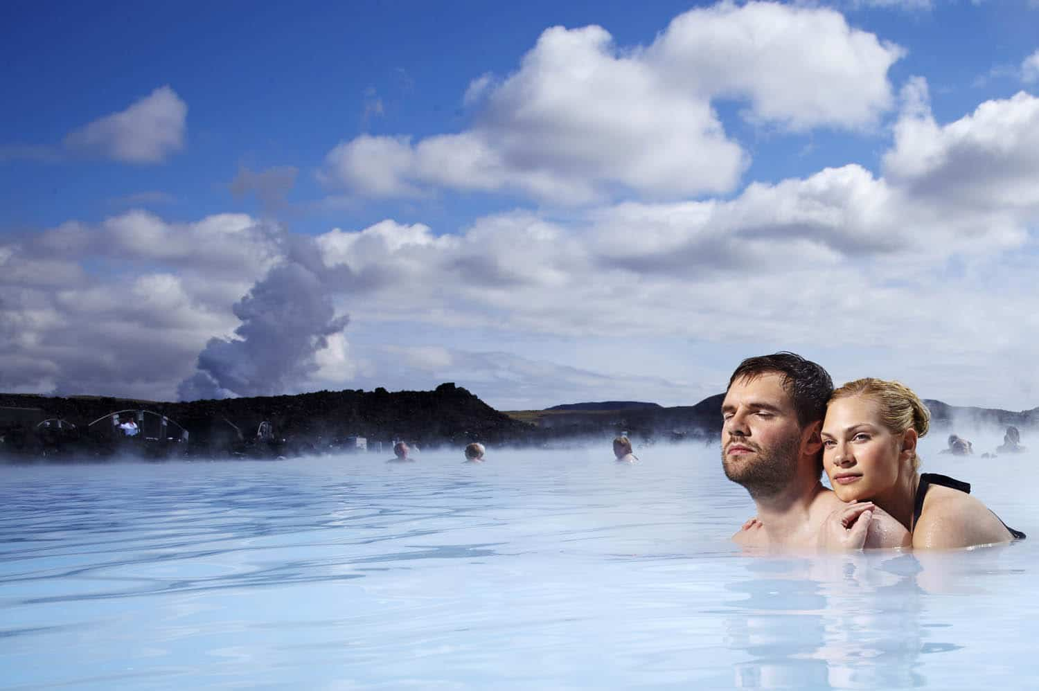 A couple bathing in Blue Lagoon