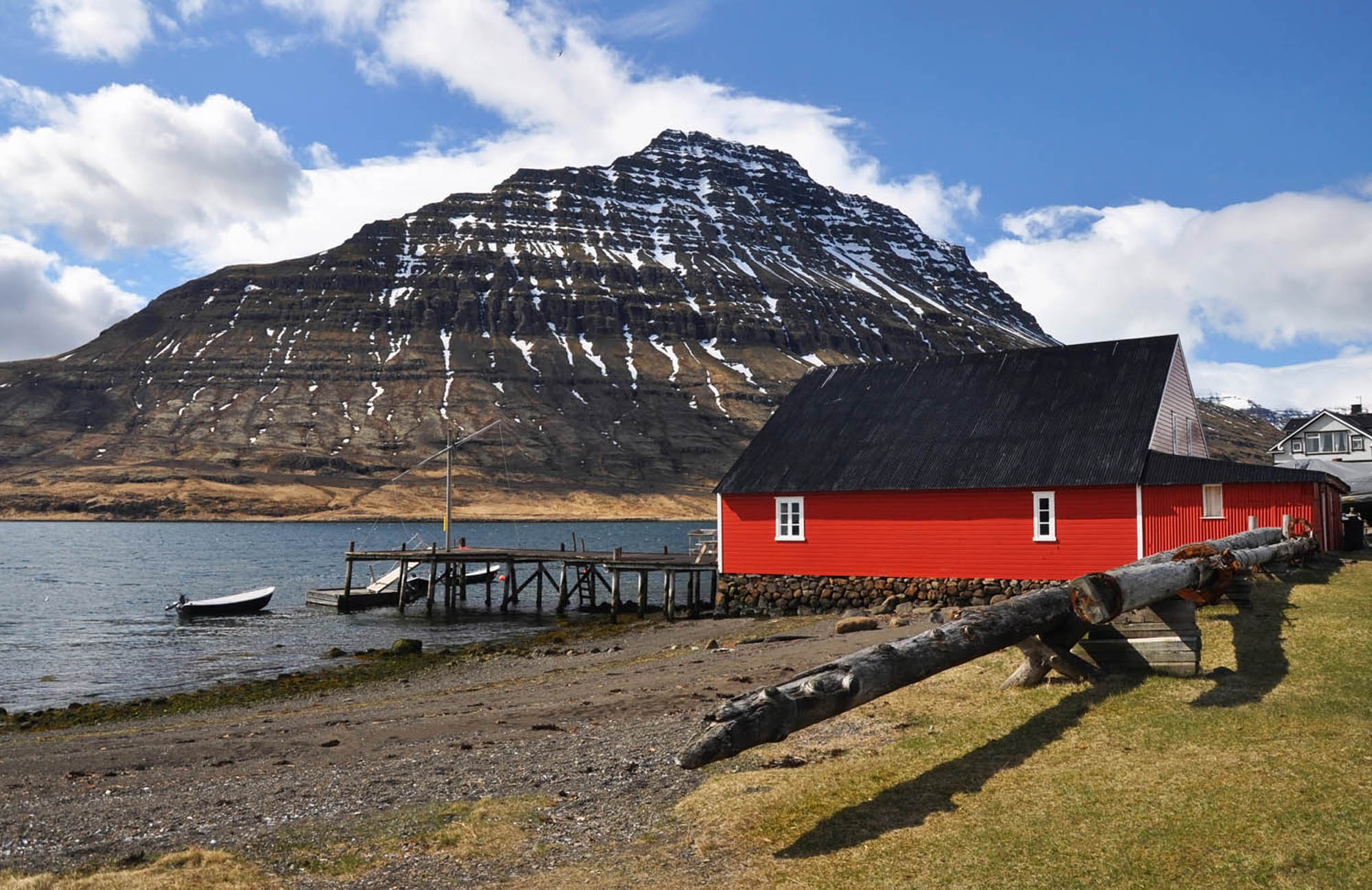 Red house at the beach in East Fjords Iceland