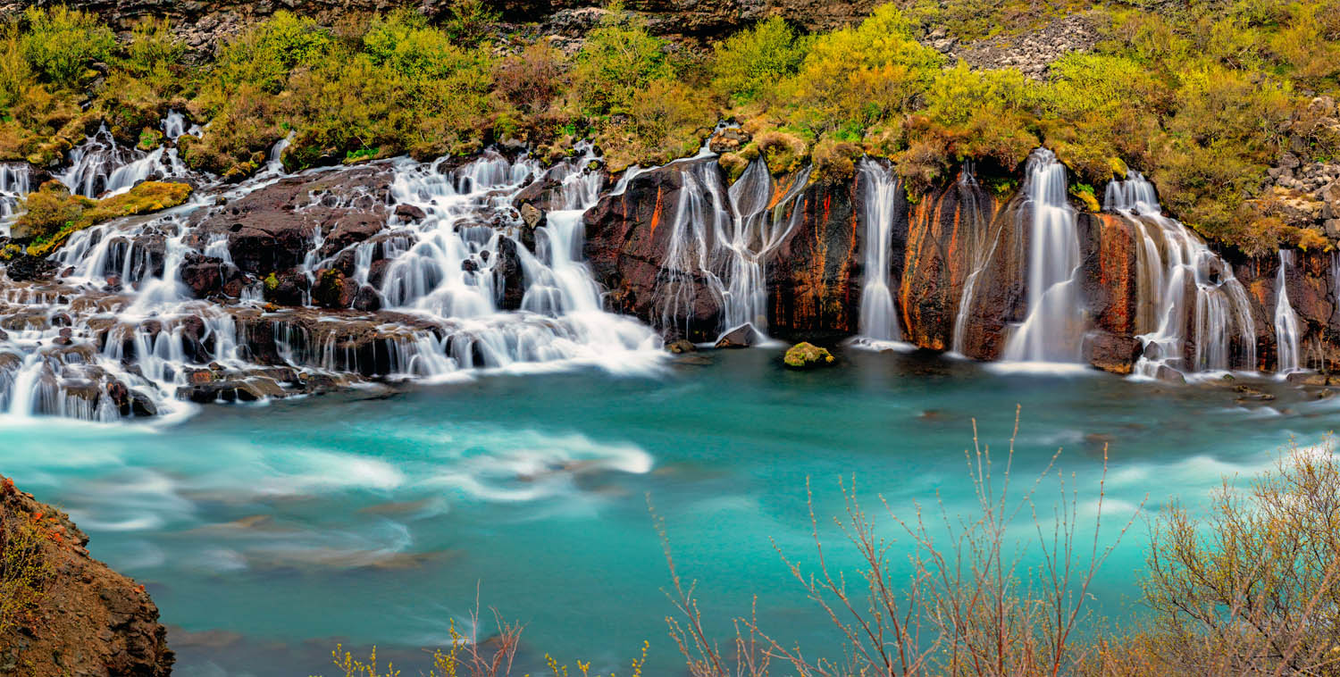 The blue water of Hraunfossar waterfall in Iceland