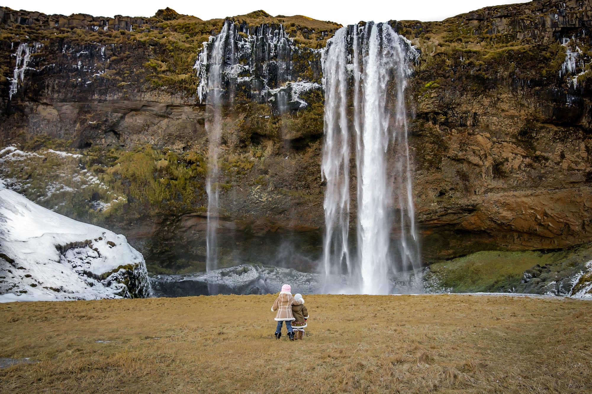 Seljalandsfoss Waterfall in winter - Iceland family vacation in winter