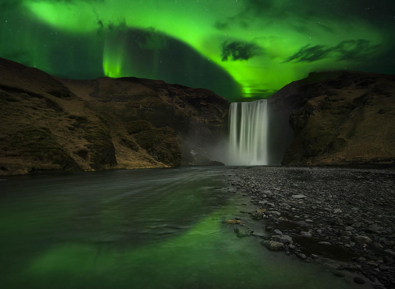Skogafoss under Northern Lights
