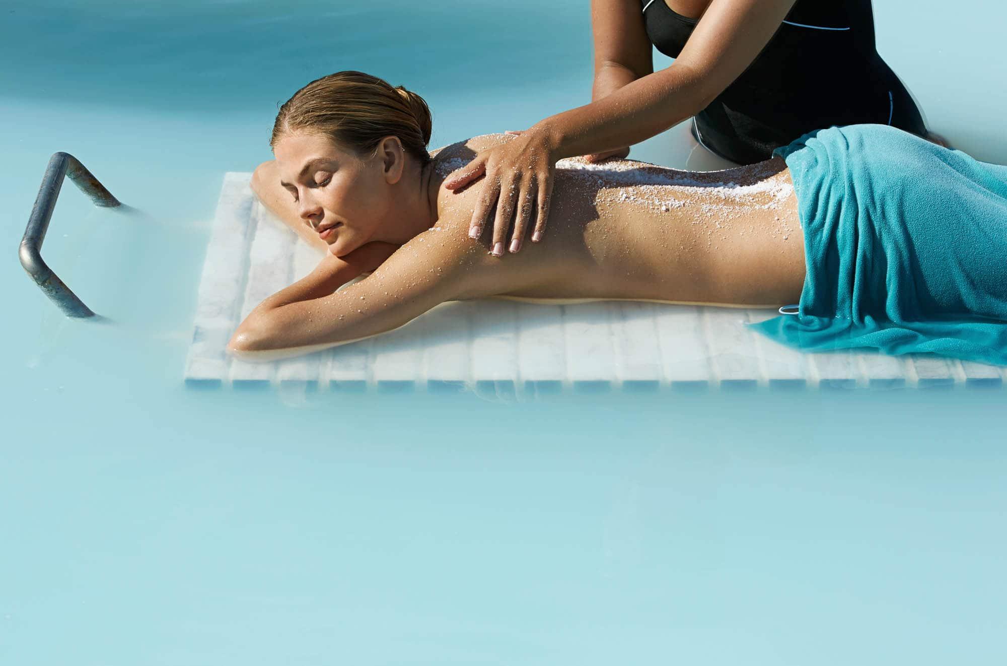 Woman enjoying massage in Blue Lagoon