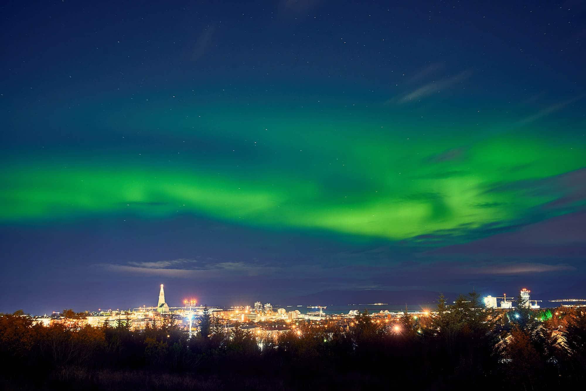 Northern Lights over Reykjavik - iceland in winter