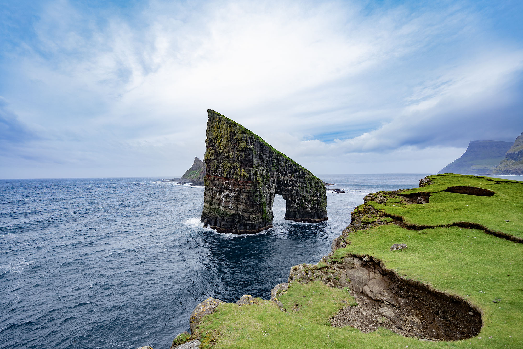 Amazing dramatic view of Drangarnir gate in front of Tindholmur in Vagar island, Faroe Islands